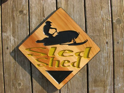 Wood sign the Sled Shed ski doo