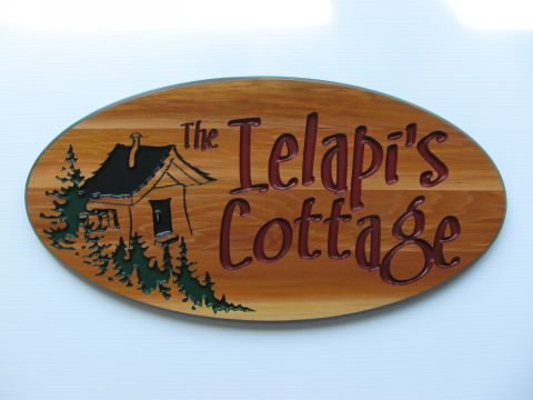Oval routered wood sign trees shack name cottage