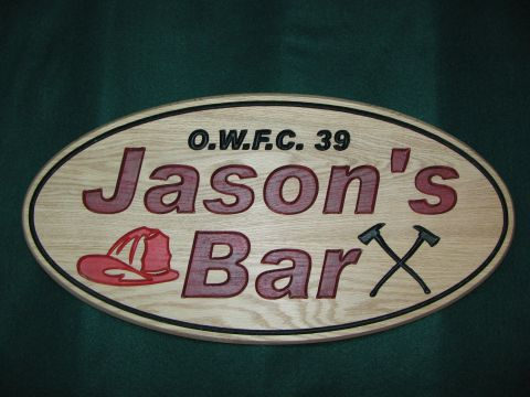 Bar sign made from oak oval shaped.